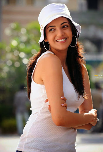 Kajal Aggarwal pics in white color tank top and white caps