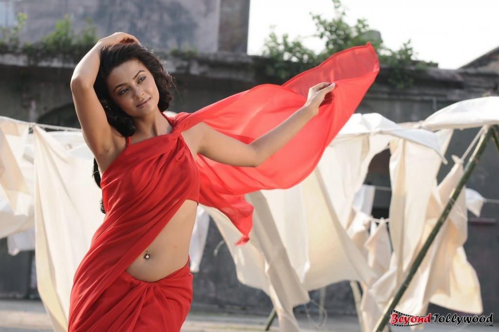 Surveen Chawla Wallpaper Hot HD Pics in Red Saree